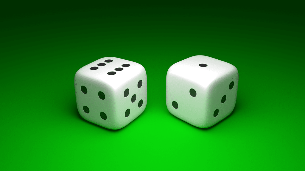 Photo of two dice on green background showing 6 and 1