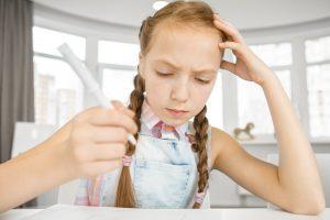 Little girl confused doing homework, hates math